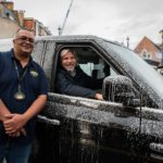 Roshan and Saul at Charity Cab Wash