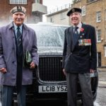 Two veterans at Charity Cab Wash