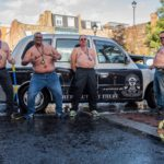 fat cabbies at charity cab wash stripped to waist