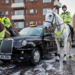 Charity Cab Wash Brian with two Police horses