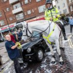 Charity Cab Wash Brian with a Police horse